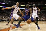 Phoenix , Az ,. Raymond Felton (2) of the New York Knicks handles the ball under pressure from Marcin Gortat (4) and Mickael Pietrus (12) of the Phoenix Suns during the NBA game at US Airways Center on January 7, 2011 in Phoenix, Arizona. The Knicks defeated the Suns 121-96. Photo by Christian Petersen/Getty Images .....