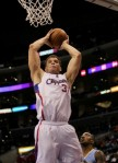 Blake Griffin (32) of the Los Angeles Clippers grabs a rebound against the Denver Nuggets at Staples Center on January 5, 2011 in Los Angeles, California. The Clippers won 106-93 . Photo by Stephen Dunn/Getty Images .......