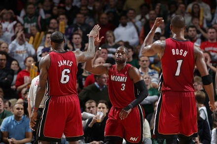 (L-R) LeBron James (#6), Dwyane Wade (3) and Chris Bosh (1) of the Miami Heat congratulate each other during the NBA game against the Milwaukee Bucks on January 7, 2011 at the Bradley Center in Milwaukee, Wisconsin. Photo by Gary Dineen/NBAE via Getty Images .....