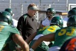 Oregon coach Chip Kelly leads his players during NCAA college football practice, Tuesday, Jan. 4, 2011, in Phoenix. Oregon is scheduled to play Auburn in the BCS Championship on Monday, Jan. 10, in Glendale, Ariz. AP Photo/Ross D. Franklin ........