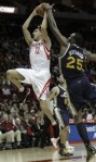 Houston Rockets' Kevin Martin (12) is fouled by Utah Jazz center Al Jefferson (25) during the second half of an NBA basketball game Saturday, Jan. 8, 2011, in Houston. The Jazz won 103-99 in overtime. AP Photo/Pat Sullivan ...........