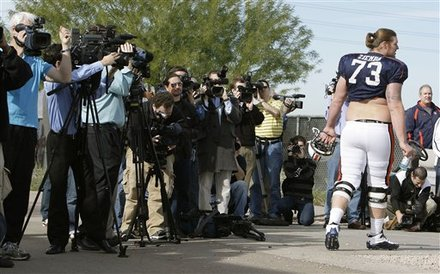 Auburn's Lee Ziemba (73) walks the gauntlet of cameras as he walks to the practice field prior to NCAA college football practice Wednesday, Jan. 5, 2011, in Scottsdale, Ariz. Auburn is scheduled to play Oregon in the BCS Championship on Monday, Jan. 10, in Glendale, Ariz. AP Photo/Ross D. Franklin ........