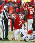 Quarterback Matt Cassel (7) of the Kansas City Chiefs is helped off the ground by the referee after being sacked in a game against the Oakland Raiders at Arrowhead Stadium on January 2, 2011 in Kansas City, Missouri. The Raiders won 31-10 . Photo by Tim Umphrey/Getty Images ......