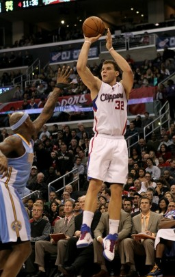 LOS ANGELES, CA - JANUARY 05: Blake Griffin (32) of the Los Angeles Clippers takes a jump shot over Al Harrington (7) of the Denver Nuggets at Staples Center on January 5, 2011 in Los Angeles, California. The Clippers won 106-93. Photo by Stephen Dunn/Getty Images .....
