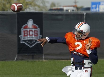 Auburn quarterback Cam Newton throws a pass as he warms up during NCAA college football practice Wednesday, Jan. 5, 2011, in Scottsdale, Ariz. Auburn is scheduled to play Oregon in the BCS Championship on Monday, Jan. 10, in Glendale, Ariz. AP Photo/Ross D. Franklin .....