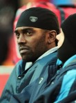 Kansas City ,Mo ,. Receiver Randy Moss (84) of the Tennessee Titans watches from the sidelines during the game against the Kansas City Chiefs on December 26, 2010 at Arrowhead Stadium in Kansas City, Missouri. Photo by Jamie Squire/Getty Images .....