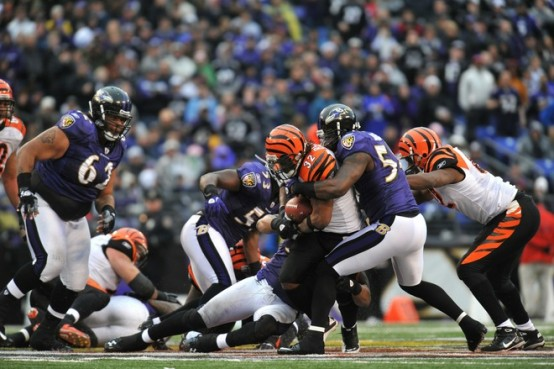 Baltimore , Md,. Cedric Benson (32) of the Cincinnati Bengals runs the ball while Ray Lewis (52) of the Baltimore Ravens makes a tackle at M&T Bank Stadium on January 2, 2011 in Baltimore, Maryland. The Ravens defeated the Bengals 13-6 . Photo by Larry French/Getty Images .............