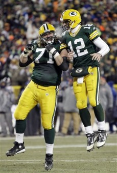 Green Bay Packers quarterback Aaron Rodgers (12) celebrates with Josh Sitton (71) after Rodgers threw a touchdown pass to Donald Lee during the second half of an NFL football game against the Chicago Bears on Sunday, Jan. 2, 2011, in Green Bay, Wis. The Packers won 10-3 . AP Photo/Morry Gash ..........