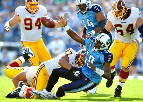 Lorenzo Alexander (97) of the Washington Redskins forces a fumble by quarterback Vince Young (10) of the Tennessee Titans during the first half at LP Field on November 21, 2010 in Nashville, Tennessee. (Photo by Grant Halverson/Getty Images ........