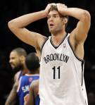 (2) Brooklyn Nets' Brook Lopez reacts after causing an offensive foul in the second half of their NBA basketball game against the New York Knicks at Barclays Center, Monday, Nov. 26, 2012, in New York. The Nets won 96-89 in overtime. (AP Photo/Kathy Willens)