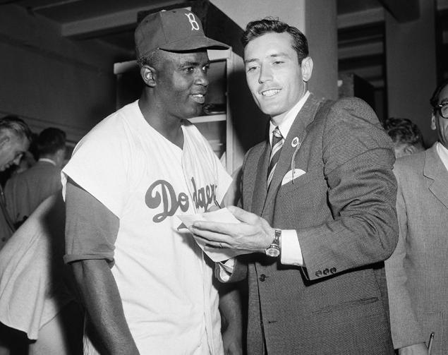 Robinson   is   seen  here     being    interviewed   by   noted    journalist    Jimmy  Piersall   .  @   copyrighted  material    LA     Times     all  rights reserved   ...